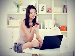 Picture_of_woman_on_computer_at_home_using_credit_card